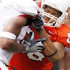 Wilson Youman, right, battles with a defender during Saturday's game against Georgia. Photo by Doug Hoke, The Oklahoman