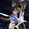 Denver\'s Danilo Gallinari (8) drives to the basket past Oklahoma City\'s Thabo Sefolosha (2) and Oklahoma City\'s Serge Ibaka (9) during the first round NBA playoff game between the Oklahoma City Thunder and the Denver Nuggets on Sunday, April 17, 2011, in Oklahoma City, Okla. Photo by Chris Landsberger, The Oklahoman
