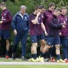 Photo - England's soccer team manager Roy Hodgson and his players arrive for a training session at London Colney, Monday, Sept. 1, 2014. England will play Norway in an international friendly soccer match at Wembley Stadium on Wednesday. (AP Photo/Kirsty Wigglesworth)