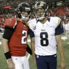 Photo - Atlanta Falcons quarterback Matt Ryan (2) speaks with St. Louis Rams quarterback Sam Bradford (8) after the second half of an NFL football game, Sunday, Sept. 15, 2013, in Atlanta. The Atlanta Falcons won 31-24.  (AP Photo/David Goldman)