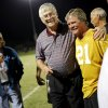 Photo - Former Cashion coach Larry Mantle talks with one of his former players, Larry Blehm, after Mantled was honored at halftime of Cashion's high school football game against Minco in Cashion, Okla., Friday, Sept. 27, 2013. Photo by Bryan Terry, The Oklahoman