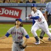 Photo - Los Angeles Dodgers' Adrian Gonzalez and New York Mets starting pitcher Jacob deGrom watch Gonzalez's three-run home run during the fifth inning of a baseball game, Saturday, Aug. 23, 2014, in Los Angeles. (AP Photo/Mark J. Terrill)