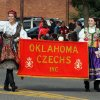 Banner holders wave to the crowd during the Czech Festival parade Saturday in Yukon. Photo by Hugh Scott, for the Oklahoman