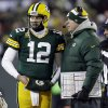 Photo - Green Bay Packers head coach Mike McCarthy talks to the Packers quarterback Aaron Rodgers (12) during the first half of an NFL wild-card playoff football game against the San Francisco 49ers, Sunday, Jan. 5, 2014, in Green Bay, Wis. (AP Photo/Mike Roemer)