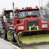 A row of trucks with snowplows are parked in the rain alone a road in Allentown, N.J., Friday, Feb. 8, 2013, as the region waits for a predicted snow storm. The light rain that fell Friday was expected to turn to snow in time for the evening rush. A blizzard warning for northeast New Jersey called for as much as 14 inches of snow. Up to 10 inches were possible for most of the state, with 2 to 5 inches in south Jersey. (AP Photo/Mel Evans)