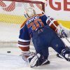 Edmonton Oilers goalie Ben Scrivens (30) is scored on by the New York Rangers during second period NHL hockey action in Edmonton, Alberta, on Sunday March 30, 2014. (AP Photo/The Canadian Press, Jason Franson)