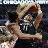 Photo - Chicago Bulls center Joakim Noah defends against a shot by Brooklyn Nets center Brook Lopez (11) during the first half in Game 6 of their first-round NBA basketball playoff series in Chicago, Thursday, May 2, 2013. (AP Photo/Nam Y. Huh)
