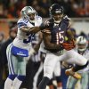 Photo - Chicago Bears wide receiver Brandon Marshall (15) makes a catch under pressure from Dallas Cowboys cornerback Brandon Carr (39) during the first half of an NFL football game, Monday, Dec. 9, 2013, in Chicago. (AP Photo/Charles Rex Arbogast)