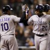 Photo -   Colorado Rockies' Wilin Rosario (20) celebrates his two-run home run with teammate Chris Nelson (10) during the eighth inning of a baseball game against the San Francisco Giants on Tuesday, Sept. 18, 2012 in San Francisco. (AP Photo/Marcio Jose Sanchez)