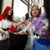MaKenna Robbins, 2, gets a handful of candy from Sarah Ex at the first Fall Fest in downtown on Friday, Oct. 25, 2013 in Norman, Okla. Photo by Steve Sisney, The Oklahoman