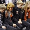 Alex Budke, left, sits next to his mother Shelley, brother Brett and daughter Sara during the memorial service for Oklahoma State head basketball coach Kurt Budke and assistant coach Miranda Serna at Gallagher-Iba Arena on Monday, Nov. 21, 2011 in Stillwater, Okla. The two were killed in a plane crash along with former state senator Olin Branstetter and his wife Paula while on a recruiting trip in central Arkansas last Thursday. Photo by Chris Landsberger, The Oklahoman