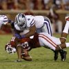 Oklahoma\'s Justin Brown (19) is brought down by Kansas State\'s Arthur Brown (4) during a college football game between the University of Oklahoma Sooners (OU) and the Kansas State University Wildcats (KSU) at Gaylord Family-Oklahoma Memorial Stadium, Saturday, September 22, 2012. Oklahoma lost 24-19. Photo by Bryan Terry, The Oklahoman