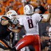 Oklahoma State\'s Cooper Bassett (80) puts pressure on Arizona\'s Nick Foles (8) during their game Thursday in Stillwater. PHOTO BY BRYAN TERRY, The Oklahoman