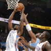 Oklahoma City\'s Serge Ibaka (9) battles under the basket with Denver\'s Nene (31) during the first round NBA playoff game between the Oklahoma City Thunder and the Denver Nuggets on Sunday, April 17, 2011, in Oklahoma City, Okla. Photo by Chris Landsberger, The Oklahoman