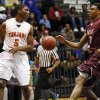 Stephen Clark (5) of Douglass passes behind his back around Deshawn Watson (32) of Northeast during a boys high school basketball game between Douglass and Northeast at Douglass High School in Oklahoma City, Friday, Feb. 8, 2013. Photo by Nate Billings, The Oklahoman