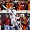 Photo - BEDLAM: Oklahoma's Jermaine Gresham (18) makes a one-handed catch over Oklahoma State's Andre Sexton (20) during the first half of the college football game between the University of Oklahoma Sooners (OU) and Oklahoma State University Cowboys (OSU) at Boone Pickens Stadium on Saturday, Nov. 29, 2008, in Stillwater, Okla.    STAFF PHOTO BY CHRIS LANDSBERGER  ORG XMIT: KOD
