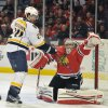 Nashville Predators\' Matt Halischuk (24) tips the puck past the Chicago Blackhawks\' Corey Crawford to score during the first period of an NHL hockey game on Friday, April 19, 2013, in Chicago. (AP Photo/Jim Prisching)