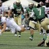 Photo - UAB safety Jay Davis (8) and cornerback Jimmy Jean (7) trip up Troy wide receiver K.D. Edenfield (13) during the second half an NCAA college football in Birmingham, Ala., Saturday, Aug. 30, 2014. UAB won 48-10. (AP Photo/The (Troy) Messenger, Thomas Graning)