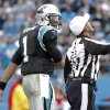 Referee Jerome Boger (23) calls an unsportsmanlike-conduct penalty on Carolina Panthers\' Cam Newton (1) during the second half of an NFL football game against the Oakland Raiders in Charlotte, N.C., Sunday, Dec. 23, 2012. (AP Photo/Bob Leverone)