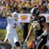 Oklahoma State\'s Brandon Weeden (3) throws a touchdown pass as Missouri\'s Luke Lambert (33) defends in the first quarter during a college football game between the Oklahoma State University Cowboys (OSU) and the University of Missouri Tigers (Mizzou) at Faurot Field in Columbia, Mo., Saturday, Oct. 22, 2011. Photo by Nate Billings, The Oklahoman