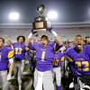 CELEBRATE / CELEBRATION: Anadarko\'s Sheldon Wilson holds the championship trophy after winning the Class 3A high school football state championship game between Cascia Hall and Anadarko 35-18 at Boone Pickens Stadium in Stillwater, Friday, Dec. 9, 2011. Photo by Bryan Terry, The Oklahoman