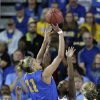 Photo - Delaware guard/forward Elena Delle Donne (11) shoots over North Carolina forward Xylina McDaniel during the first half of a second-round game in the women's NCAA college basketball tournament in Newark, Del., Tuesday, March 26, 2013. (AP Photo/Patrick Semansky)