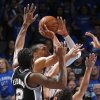 Oklahoma City\'s Russell Westbrook (0) goes to the basket as he is defended by San Antonio\'s Kawhi Leonard (2) and Marco Belinelli (3) during Game 3 of the Western Conference Finals in the NBA playoffs between the Oklahoma City Thunder and the San Antonio Spurs at Chesapeake Energy Arena in Oklahoma City, Sunday, May 25, 2014. Photo by Bryan Terry, The Oklahoman