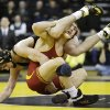 Iowa\'s Mike Evans tries to take down Iowa State\'s Tanner Weatherman during their 174-pound match in an NCAA college wrestling meet, Saturday, Dec. 1, 2012, in Iowa City, Iowa. (AP Photo/Charlie Neibergall)