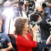 Photo - Actress Sophia Loren, front center, takes a photo as she sits with photographers during a photo call for Human Voice (Voce Umana) at the 67th international film festival, Cannes, southern France, Wednesday, May 21, 2014. (AP Photo/Alastair Grant)