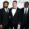 Photo - Steve McQueen, right, Chiwetel Ejiofor, left, and Brad Pitt arrive at the 25th annual Producers Guild of America Awards at the Beverly Hilton Hotel in Beverly Hills, Calif. on Sunday, Jan. 19, 2014. (Photo by Matt Sayles/Invision/AP)