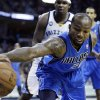 Dallas Mavericks\' Dominique Jones (20) reaches for a loose ball during the first half of an NBA basketball game as Memphis Grizzlies\' Zach Randolph, center, participates in Memphis, Tenn., Friday, Dec. 21, 2012. (AP Photo/Danny Johnston)