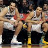 Ryan Anderson of the New Orleans Hornets, left and Stephen Curry of the Golden State Warriors watch the 3-point contest during NBA basketball All-Star Saturday Night, Feb. 16, 2013, in Houston. (AP Photo/Pat Sullivan)