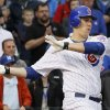 Chicago Cubs\' Bryan LaHair hits the game-winning RBI single off Houston Astros relief pitcher Hector Ambriz during the ninth inning of a baseball game, Wednesday, Oct. 3, 2012, in Chicago. The Cubs won 5-4. (AP Photo/Charles Rex Arbogast)