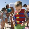 5-year-old Ryan Bussert learns to put on a life jacket during the Itty Bitty Beach Party at Pelican Bay Aquatic Center in Edmond, OK, Saturday, June 14, 2008. The kids learned about water safety and water safety exercise. BY PAUL HELLSTERN, THE OKLAHOMAN