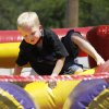 Brett Reed, 4, goes through an inflatable obstacle course during the Festival of the Child at Yukon City Park Saturday, May 7, 2011. Photo by Doug Hoke, The Oklahoman.