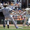San Francisco Giants\' Angel Pagan, right, reaches first base safely after a fielding error by Chicago Cubs starting pitcher Jeff Samardzija during the first inning of a baseball game on Monday, May 26, 2014, in San Francisco. (AP Photo/Marcio Jose Sanchez)