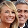 Stacy Keibler,left, and George Clooney arrive before the 84th Academy Awards on Sunday, Feb. 26, 2012, in the Hollywood section of Los Angeles. (AP Photo/Joel Ryan) ORG XMIT: OSC180