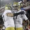 UCLA quarterback Brett Hundley, right, celebrates his 5-yard touchdown run with teammate Ian Taubler against Stanford during the first half of the Pac-12 championship NCAA college football game in Stanford, Calif., Friday, Nov. 30, 2012. (AP Photo/Tony Avelar)