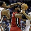 Milwaukee Bucks\' Larry Sanders (8) and Monta Ellis, right, try to steal the ball from Miami Heat\'s LeBron James during the first half of Game 3 in their first-round NBA basketball playoff series on Thursday, April 25, 2013, in Milwaukee. (AP Photo/Morry Gash)