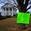 A sign posted on a tree in front of the Midland City Town Hall on Monday, Feb. 4, 2013 asks for prayers and a safe rescue for a boy named Ethan who was taken hostage last week. Authorities stormed an underground bunker Monday in Alabama, freeing the 5-year-old boy who had been held hostage in the tiny underground shelter and leaving the boy\'s abductor dead. (AP Photo/The Dothan Eagle, Jay Hare)