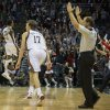 Photo -   Milwaukee Bucks' Brandon Jennings, left, reacts to his game winning shot at the buzzer to defeat the Cleveland Cavaliers 105-102 in the second half of an NBA basketball game, Saturday Nov. 3, 2012 in Milwaukee. (AP Photo/Tom Lynn)