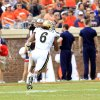 Photo - UCLA linebacker Eric Kendricks (6) returns an interception for a touchdown during the first half of an NCAA college football game against Virginia at Scott Stadium, Saturday, Aug. 30, 2014, in Charlottesville, Va. (AP Photo/Andrew Shurtleff)