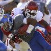 OU\'s Charles Tapper (91) brings down KU\'s Montell Cozart (2) during the college football game between the University of Oklahoma Sooners (OU) and the University of Kansas Jayhawks (KU) at Memorial Stadium in Lawrence, Kan., Saturday, Oct. 19, 2013. Oklahoma won 34-19. Photo by Bryan Terry, The Oklahoman