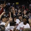 Louisville\'s team celebrates after defeating Tennessee during the Oklahoma City regional final game in the women\'s NCAA college basketball tournament in Oklahoma City, Tuesday, April 2, 2013. Louisville own 86-78. (AP Photo/Alonzo Adams)