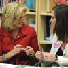 Ann Romney, wife of Republican Presidential candidate, former Massachusetts Gov. Mitt Romney, left, speaks with breast cancer survivor Rachell Moodie, 27, of Wesley Chapel, at the Center for Women\'s Oncology at Moffitt Cancer Center Wednesday, Oct. 10, 2012 in Tampa, Fla. Romney made a stop at Moffitt for a tour of the facility. (AP Photo/The Tampa Tribune, Chris Urso, Pool)