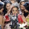 Photo - Miss USA, Olivia Culpo, center, smiles for the television camera as she is congratulated by other contestants after being crowned as Miss Universe during the Miss Universe competition, Wednesday, Dec. 19, 2012, in Las Vegas. (AP Photo/Julie Jacobson)