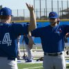 Photo - Toronto Blue Jays pitchers Brett Cecil, right, and Casey Janssen (44) warm up at Spring Training in Dunedin, Fla. on Thursday Feb. 20, 2014.  (AP Photo/The Canadian Press, Frank Gunn)