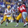 Photo -   LSU quarterback Zach Mettenberger (8) scrambles pastMississippi defensive lineman Issac Gross (94) in the first half of an NCAA college football game in Baton Rouge, La., Saturday, Nov. 17, 2012. (AP Photo/Gerald Herbert)