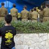 An Israeli man wears a T-shirt with the Golani brigade unit symbol during the funeral of Sgt. Sean Mondshane, at a cemetery in Tel Aviv, Israeli, Tuesday, July 22, 2014. Mondshane, who served in the Golani brigade, was killed in fighting in the Gaza Strip on Sunday. (AP Photo/Oded Balilty)