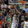 Photo - Indiana Pacers center Roy Hibbert (55) blocks a shot by Utah Jazz forward Paul Millsap (24) in the first half during an NBA basketball game on Saturday, Jan. 26, 2013, in Salt Lake City. (AP Photo/Steve C. Wilson)
